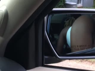 Black Hoooker sucking dick in car. View of ass