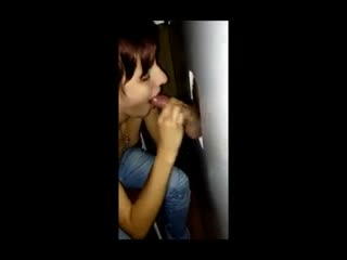 Economic Whore sucks 20 cocks at the gloryhole