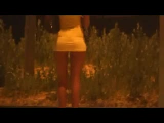 Street Prostitute waiting customers at roundabout